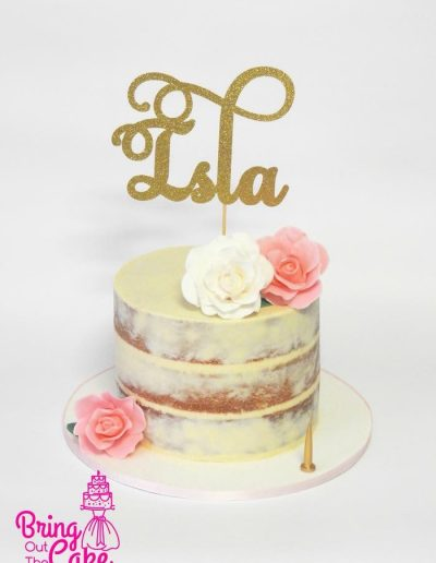 Semi naked first birthday cake with custom topper