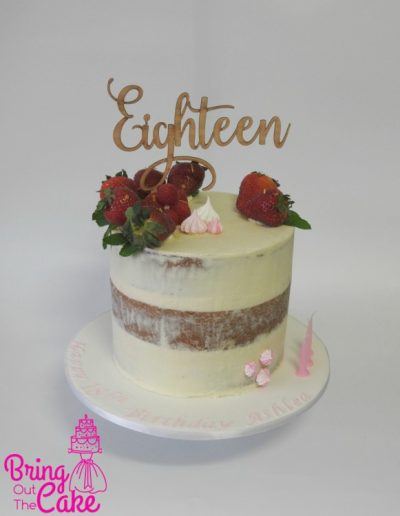 Semi Naked Cake with meringues, strawberries and wooden topper