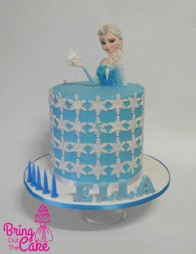 Frozen cake with snowflakes and edible image topper